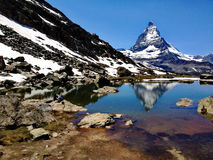 Matterhorn Peak reflection in summer at Riffelsee lake, Gornergrat station, Zermatt, Switzerland stock photography