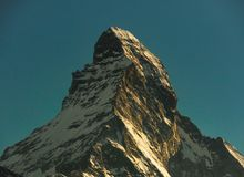 Matterhorn peak during sunset, view from gornergrat train station, Zermatt, Switzerland. royalty free stock photo