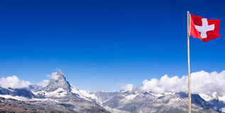 Matterhorn peak, Switzerland. Matterhorn peak with Switzerland flag Stock Images