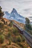 Matterhorn peak with Gornergrat train in Zermatt area, Switzerland. Famous Matterhorn peak with Gornergrat train in Zermatt area, Switzerland royalty free stock images