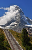 Matterhorn with railroad. Mountain railroad in front of Matterhorn peak stock photos