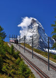 Matterhorn with railroad and train. Mountain train in front of Matterhorn peak stock photography