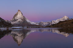 Matterhorn reflected in the Riffelsee. The Matterhorn (4478m) and Dente Blanche (4357m) reflected in the Riffelsee (Switzerland) in the first moring light Stock Photos
