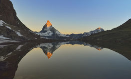 Matterhorn reflected in the Riffelsee. Stock Photo