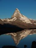 Matterhorn Reflection In Stellisee During Sunrise. Matterhorn, Dent Blanche And Obergabelhorn reflecting in Stellisee During Sunrise Stock Photos