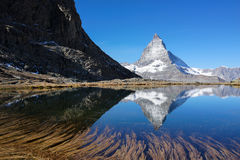 Matterhorn with reflection in lake with clear blue sky Stock Photos