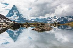 Matterhorn reflection in the lake stock photography