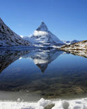 Matterhorn reflection on Riffelsee Lake, Alps Stock Photo