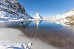 Matterhorn with reflection in Riffelsee, Zermatt, Switzerland Royalty Free Stock Image