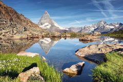 Matterhorn and reflection on the water surface at the morning time in Switzerland. Matterhorn and reflection on the water surface at the morning time. Beautiful stock photos