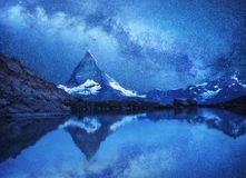 Matterhorn and reflection on the water surface at the night time. Milky way above Matterhorn, Switzerland. Beautiful natural landscape in the Switzerland stock photos