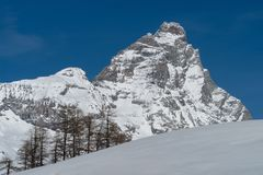 The Matterhorn from Breuil-Cervinia, Italy. Matterhorn seen from Breuil in winter. On the left is the Lion`s Head Royalty Free Stock Photography