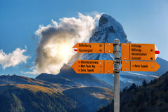 Matterhorn with Signpost in Swiss Alps. Famous Matterhorn with Signpost in Swiss Alps stock photography