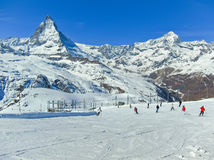 Matterhorn with some skiers skiing Royalty Free Stock Images