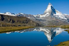 The Matterhorn with Stelisee. The Matterhorn reflected in the Stelisee in the swiss alps Stock Image