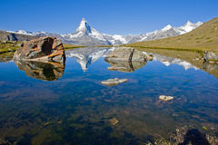 Matterhorn, Stelisee and two rocks Stock Photography