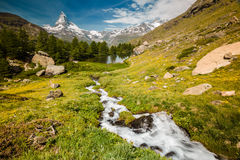 Matterhorn with stream flowing to lake Grindjisee Royalty Free Stock Photos