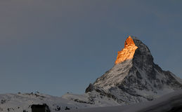 Matterhorn at sunrise. A beautiful scenic view of the morning's first light on the top of the famous Matterhorn Royalty Free Stock Photo