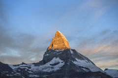 Matterhorn sunrise. Dawn, sunrise scene of the amazing matterhorn mountain in the Swiss Alps. the sky lights up in an incredible display of colour and the shadow Stock Photos