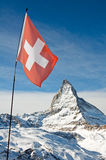 Matterhorn with the Swiss flag Stock Image
