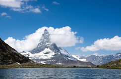Matterhorn, Valais, Switzerland. Photo of the Matterhorn, the famous mountain in Switzerland. Location at the Lake Riffel. Visited in Summertime Royalty Free Stock Photo