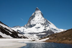 Matterhorn view. Classic view on the Matterhorn from the Riffelsee at the Gornergrad Royalty Free Stock Images