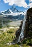Matterhorn with waterfal. Matterhorn mountain peak with waterfall in summer, Zermatt, Switzerland Stock Images