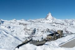 Matterhorn in winter at Gornegrat train station. View of the Matterhorn in winter at Gornegrat train station and clear sky stock photos