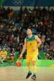 Matthew Dellavedova de Team Australia na ação durante o fósforo de basquetebol do grupo A do Rio 2016 Jogos Olímpicos contra a eq Fotografia de Stock