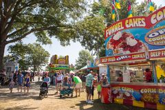 Community Street Festival. MATTHEWS, NC - September 4, 2017: Families walk through the midway at the 25th annual `Matthews Alive` street festival Stock Photos