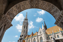 Matthias church in Budapest, Hungary. Matthias church as seen through the arches of the Fishermen's Bastion in Buda Castle district, Budapest, Hungary Royalty Free Stock Image