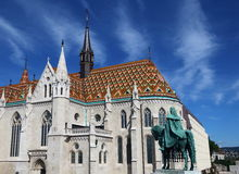 Matthias Church 1. Exterior of Matthias Church, with the statue of King Stephen in the foreground, Budapest, Hungary Stock Photo