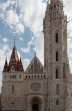 Matthias Church. Located in Budapest, Hungary, in front of the Fisherman`s Bastion at the heart of Buda`s Castle District Stock Images