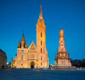 Matthias church and Statue of Holy Trinity in Budapest, Hungary Royalty Free Stock Photos