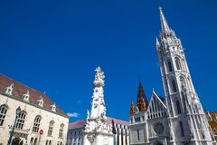 Matthias Church and the Statue of the Holy Trinity at Buda Castle District. Matthias Church and the Statue of the Holy Trinity at the heart of Buda Castle royalty free stock photos