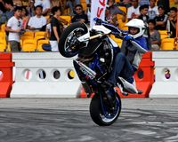 Mattie Griffin performing a wheelie with his bike stock image
