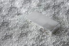 Mattone d'argento nei pezzi di argento fotografie stock