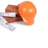 Mattone della costruzione con un casco Immagini Stock Libere da Diritti