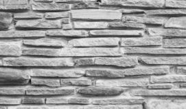 Mattone di pietra esile grigio su dettagliato Fondo esile del mattone, testo immagini stock