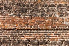 Mattone e vecchio fondo di pietra della parete immagini stock libere da diritti