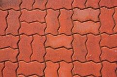 Mattone rosso su terra Immagini Stock