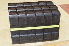 Mattonella di carbone, blocchetto della mattonella di carbone, blocchetti della mattonella di carbone, mucchio delle mattonelle d Immagine Stock
