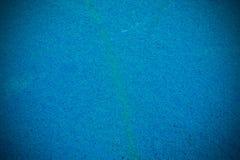 Mattonelle blu profonde con un difetto Fotografia Stock