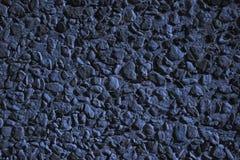 Mattonelle di pietra sulla terra alla notte Immagine Stock