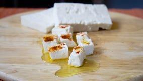 Mattonelle e cubi del formaggio Immagine Stock