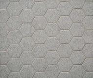 Mattonelle grige della pietra di esagono per gli interni Sono usati pricipalmente per i bagni, sulla parete o sul pavimento fotografie stock libere da diritti
