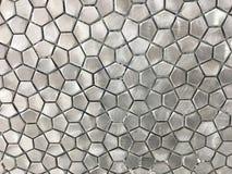 Mattonelle metalliche dell'acciaio inossidabile in un modello geometrico Immagini Stock