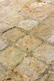 Mattonelle quadrate del cemento della via di lerciume Fotografia Stock Libera da Diritti