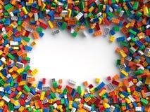 Mattoni colorati del giocattolo con il posto per il vostro contenuto Immagini Stock