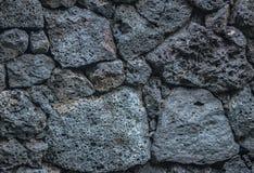Mattoni di pietra del fondo di struttura del vulcano nella parete immagine stock